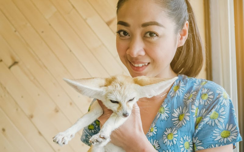 Female with Fennec fox - ExoPetGuides.com